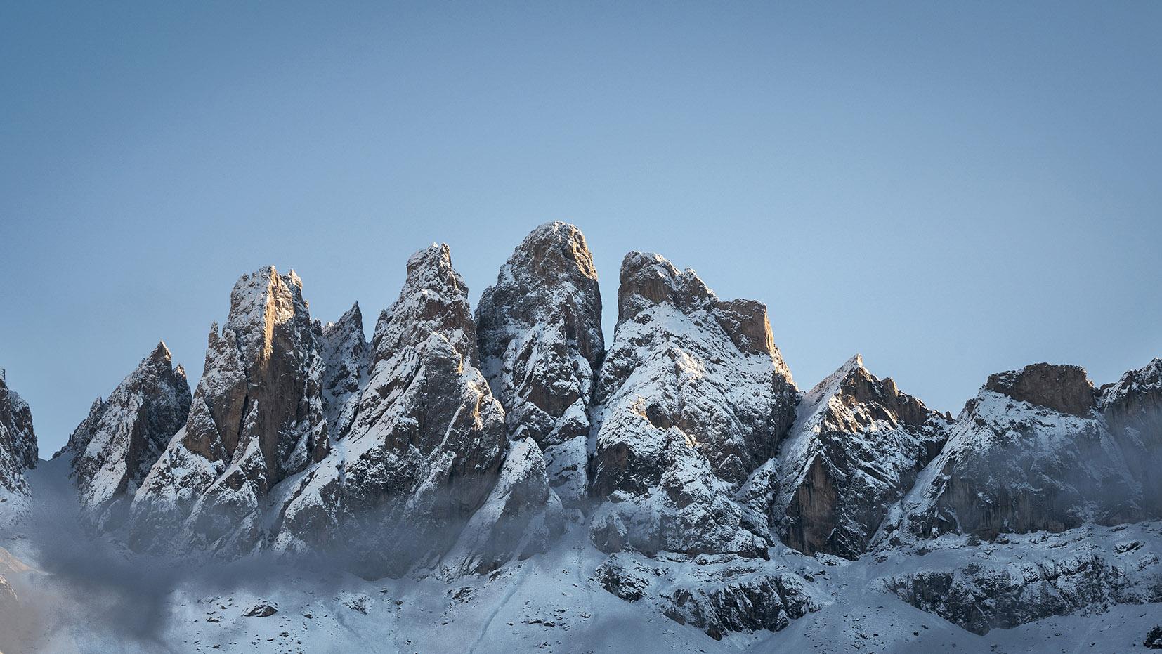 coucher soleil Sass Rigais forme dragon ciel bleu neige